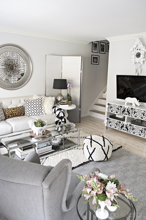 neutral living room decor with black and white accents, Beni Ourain rug, letter sofa - Cuckoo4Design