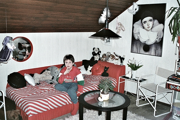 80s childhood bedroom with Pierro the clown and red and white decor