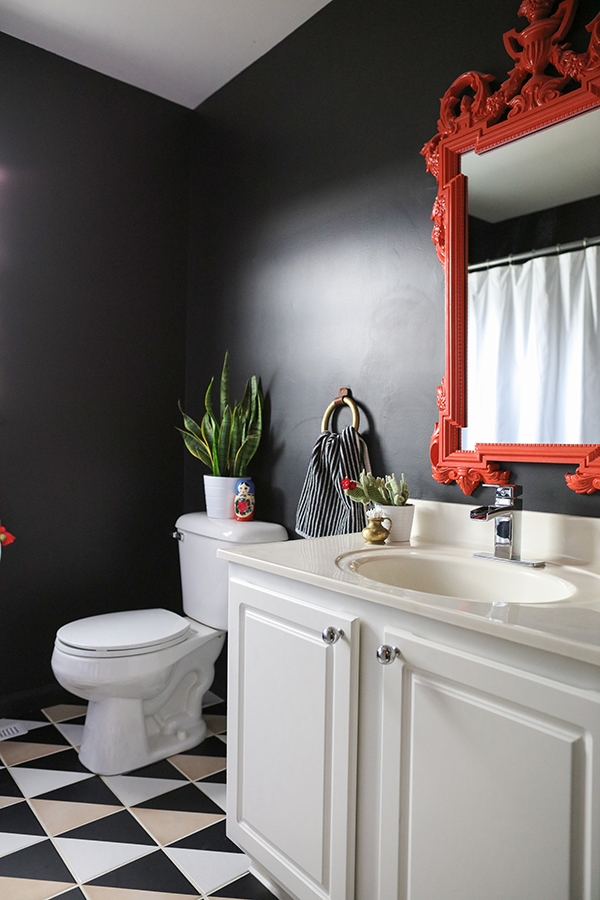 black bathroom with graphic patterned tile