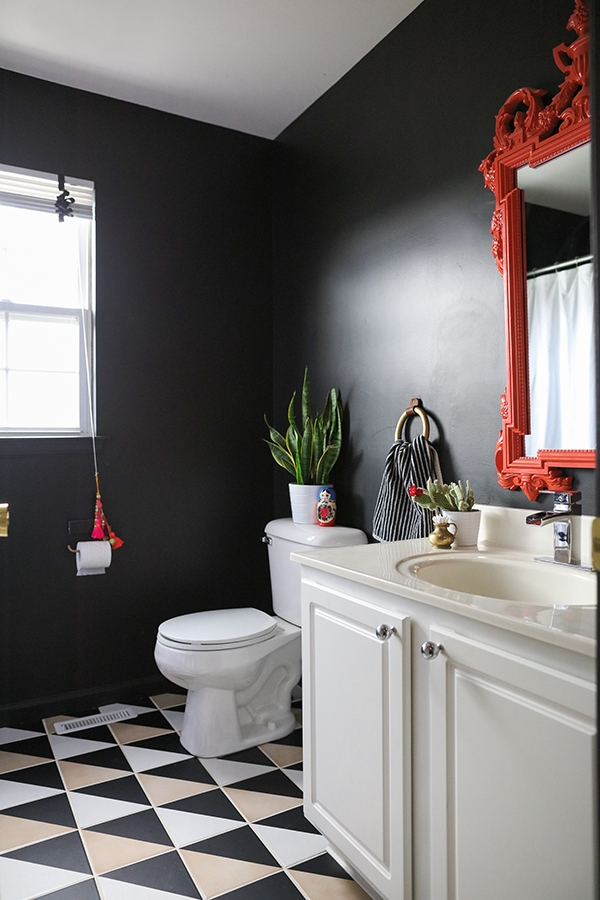 black bathroom with graphic patterned tile before budget bathroom remodel