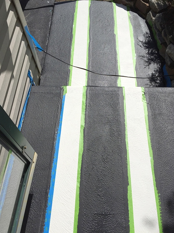 rolling out your black stripe on the concrete porch