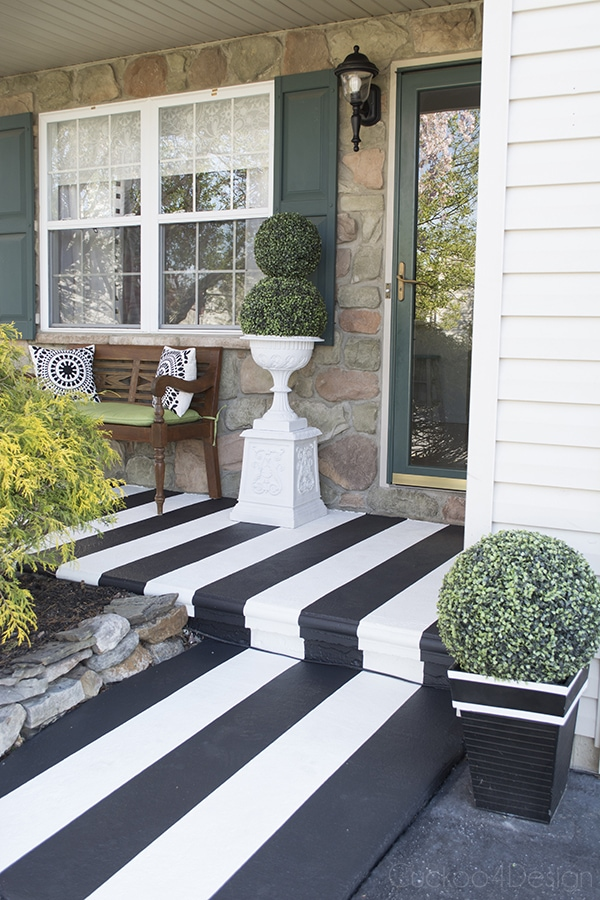 view from driveway of striped front porch