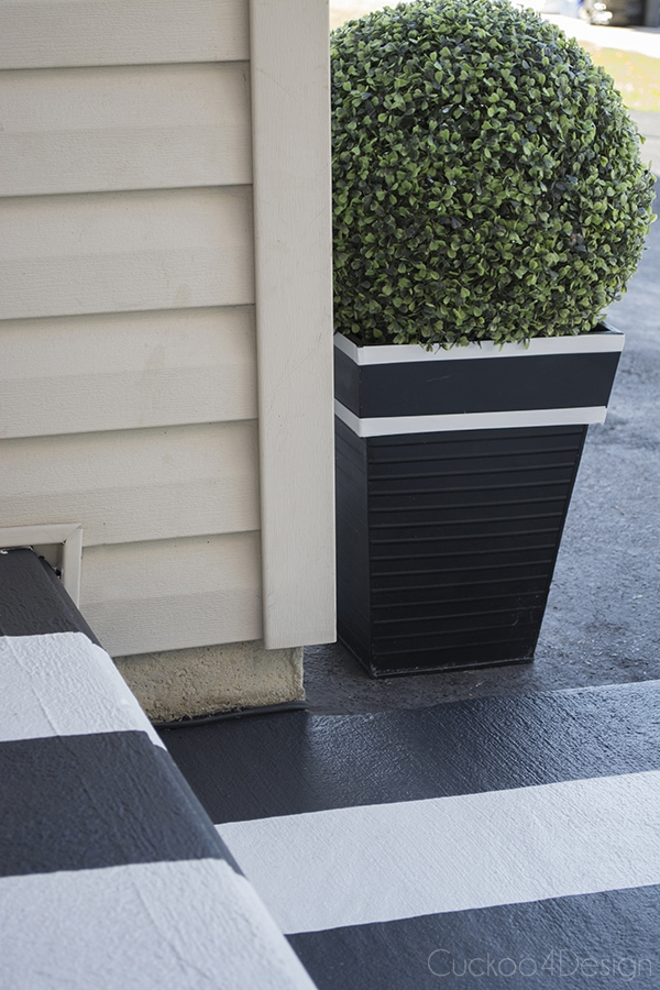 black and white planter with faux boxwood ball
