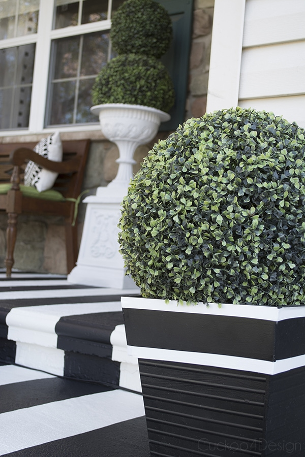 black and white planters with faux boxwood balls