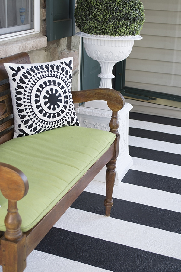 striped concrete front porch with bench