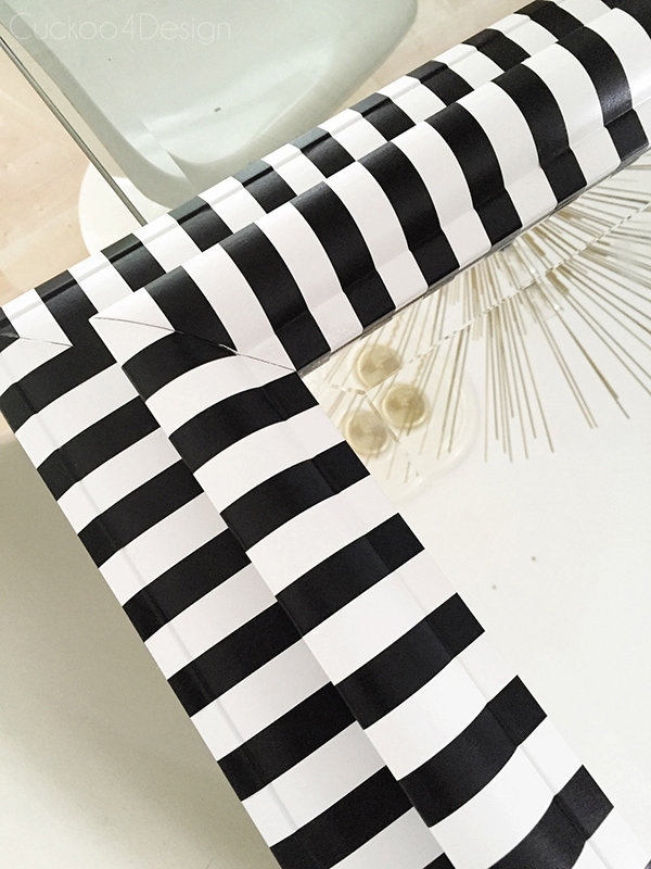 corner detail of black and white striped mirror