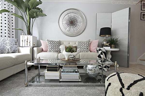 black and white neutral living room with hints of pink and leopard