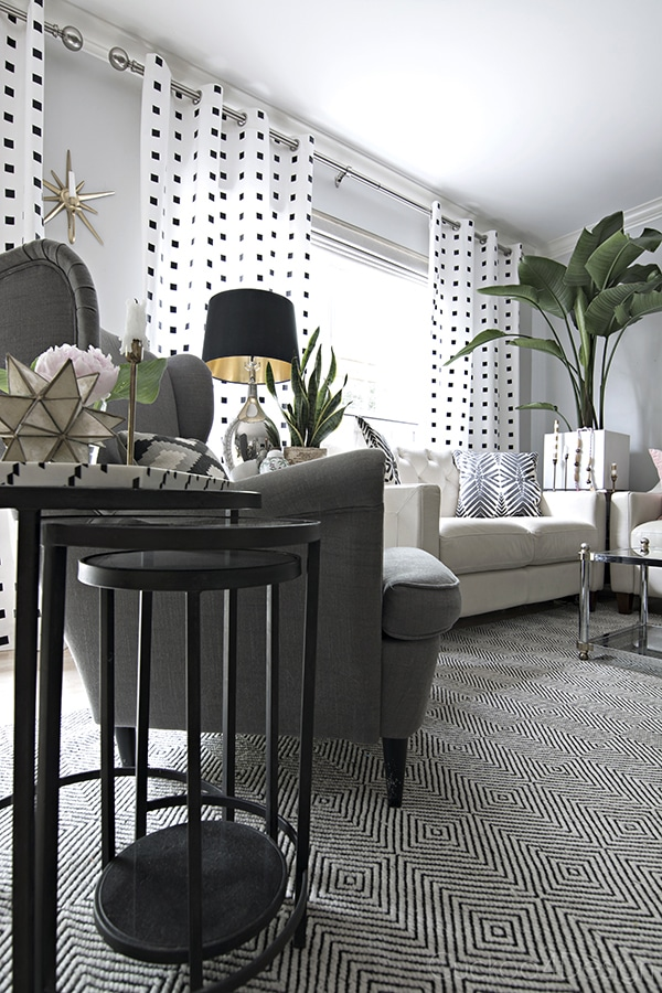 wrought iron nesting tables in black and white living room