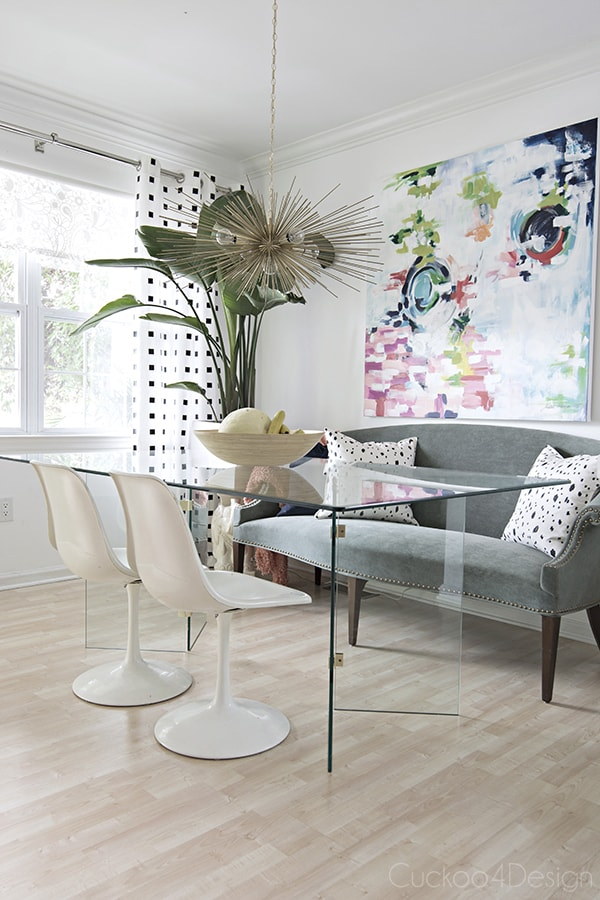 modern eclectic dining room with colorful abstract art and brass urchin chandelier