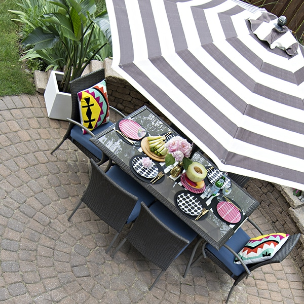 fun colorful patio with black and white striped umbrella