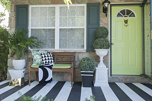 beautiful black and white front door with bright green front door