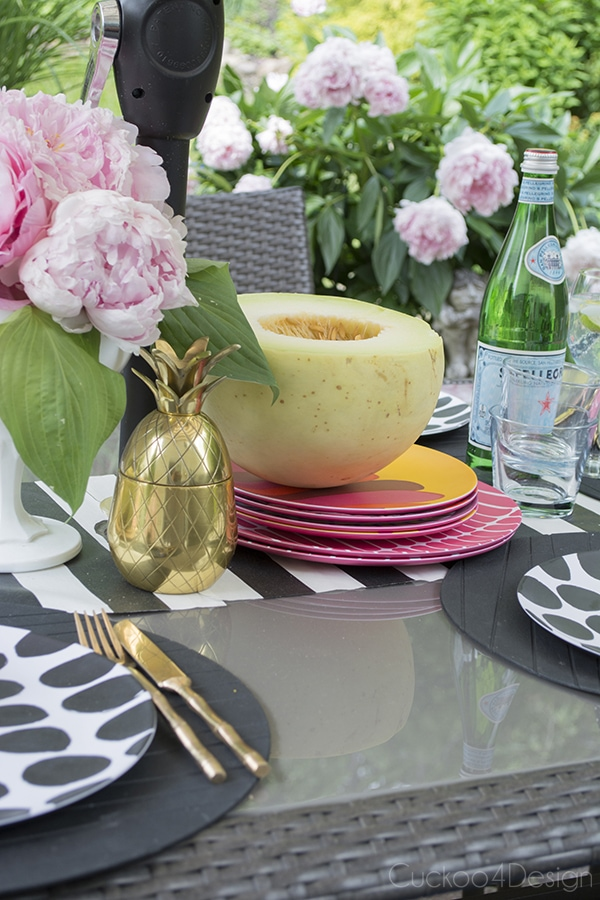 Marimekko plates on patio table setting with brass pineapple
