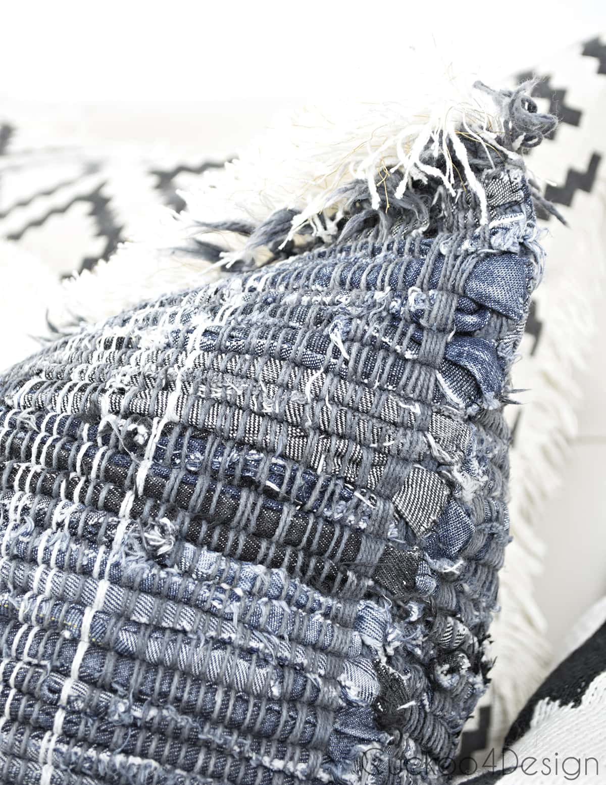 finished boho jeans DIY pillow covers with brush fringe trim