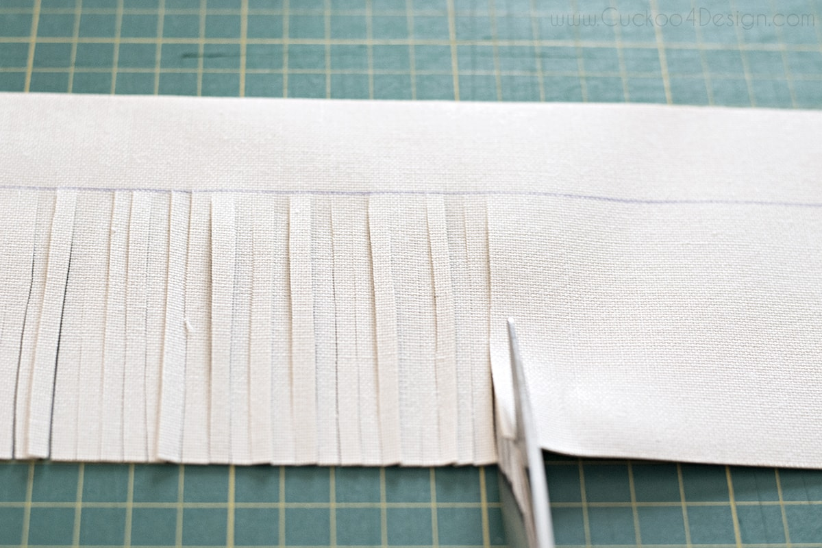 cutting the savaged leather strips in small sections with scissors