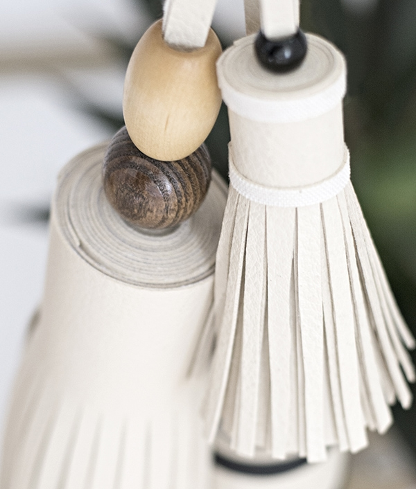 wood beads on top of leather tassels