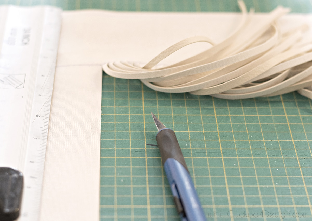 cutting the recycled pieces of leather from the sofa with a knife