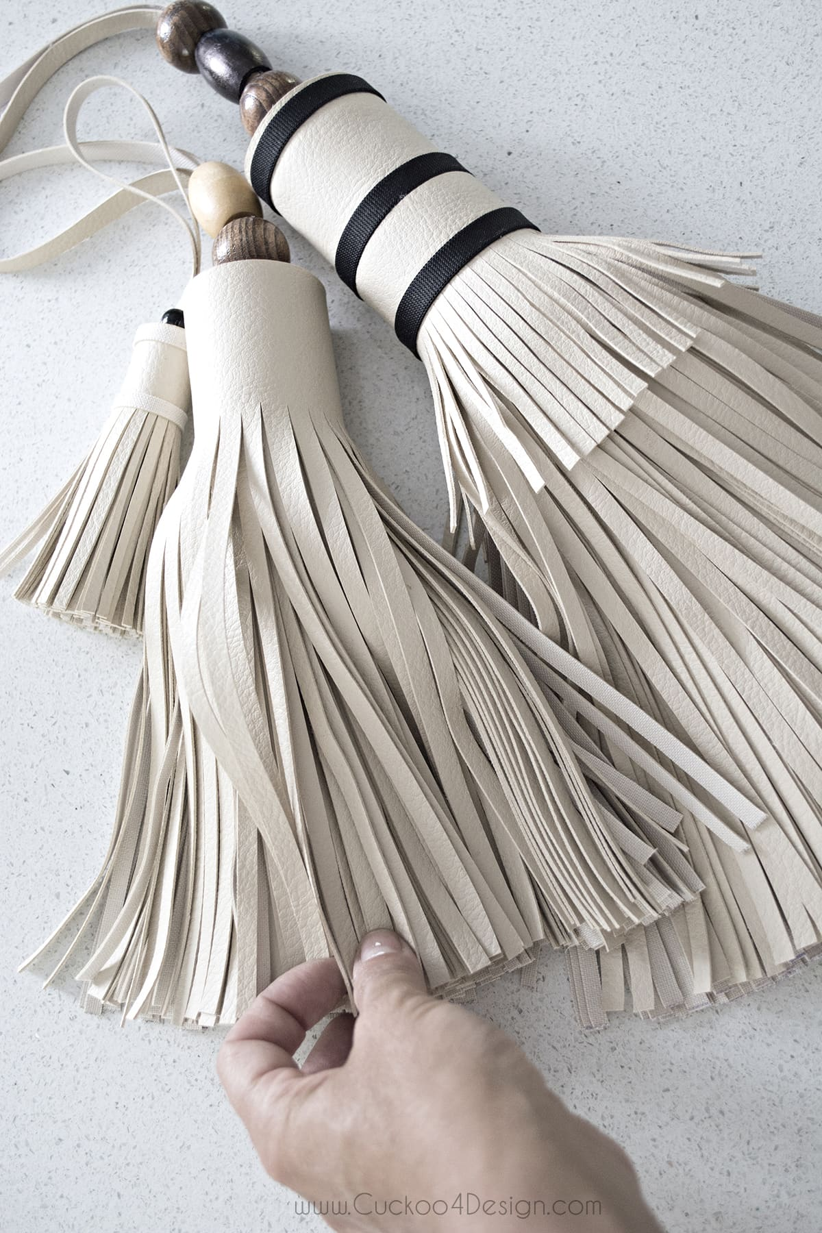 group of three large leather tassels