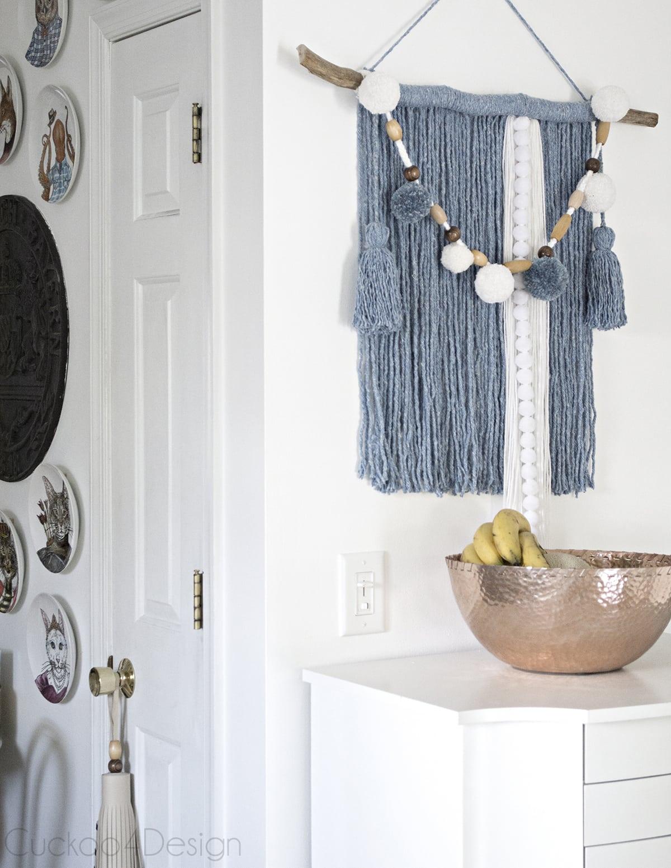 mop head yarn wall hanging in kitchen