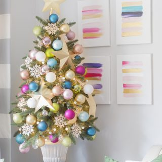 Colorful Christmas Home Tour with large gold stars and pink, turquoise, green and white ball ornaments