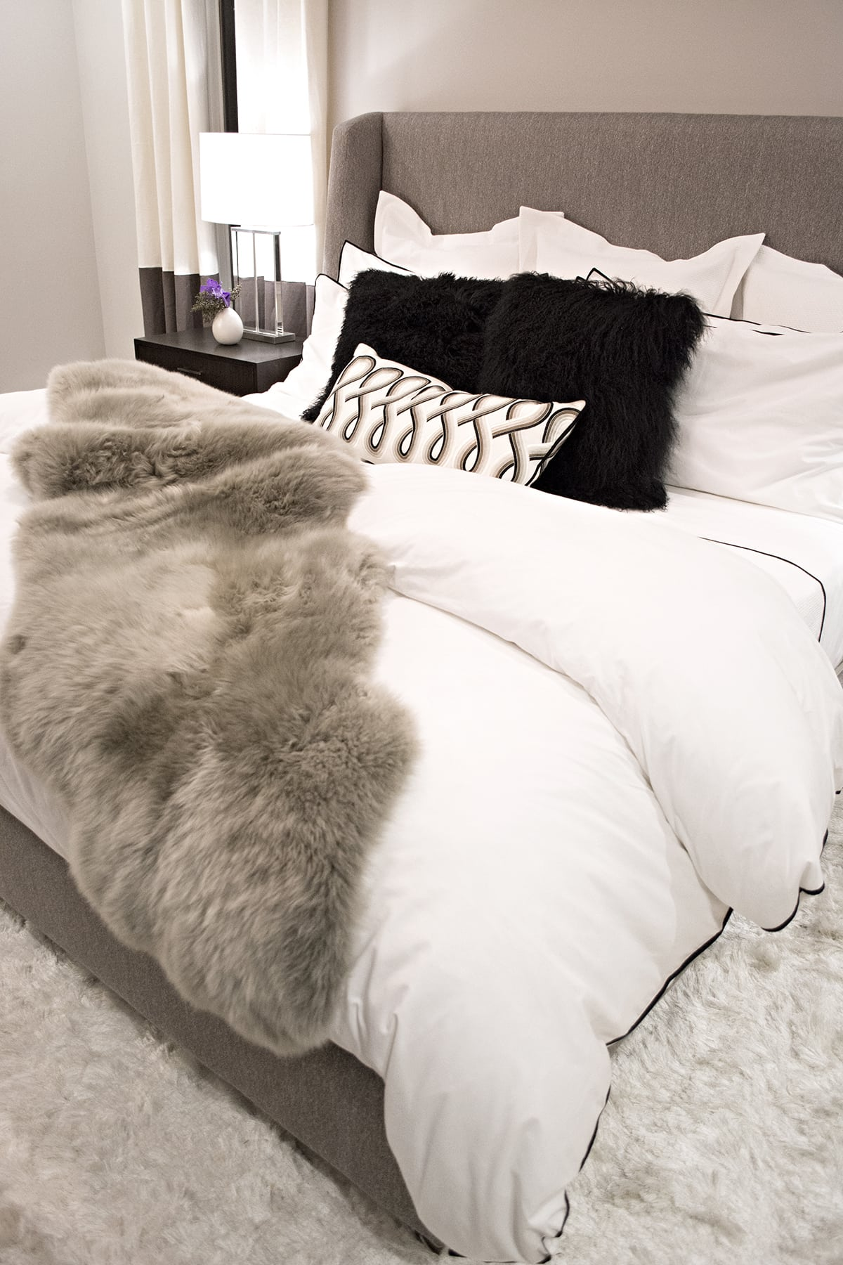 cozy gray kingsized upholstered bed
