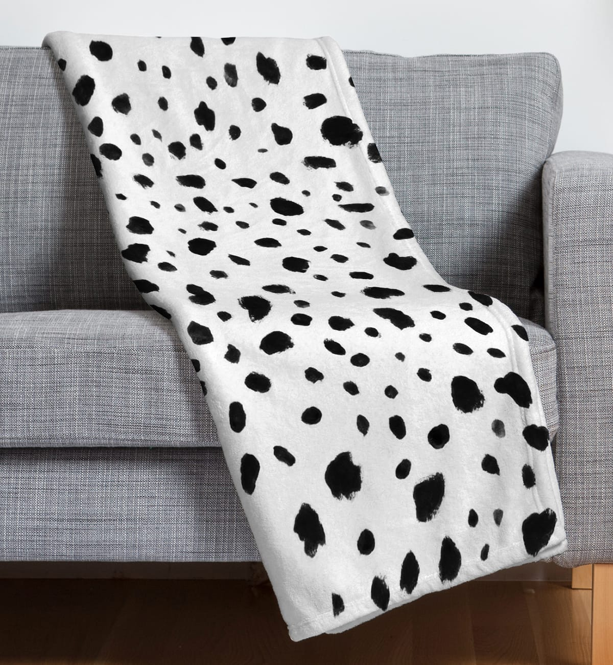 black and white dotted dalmatian throw