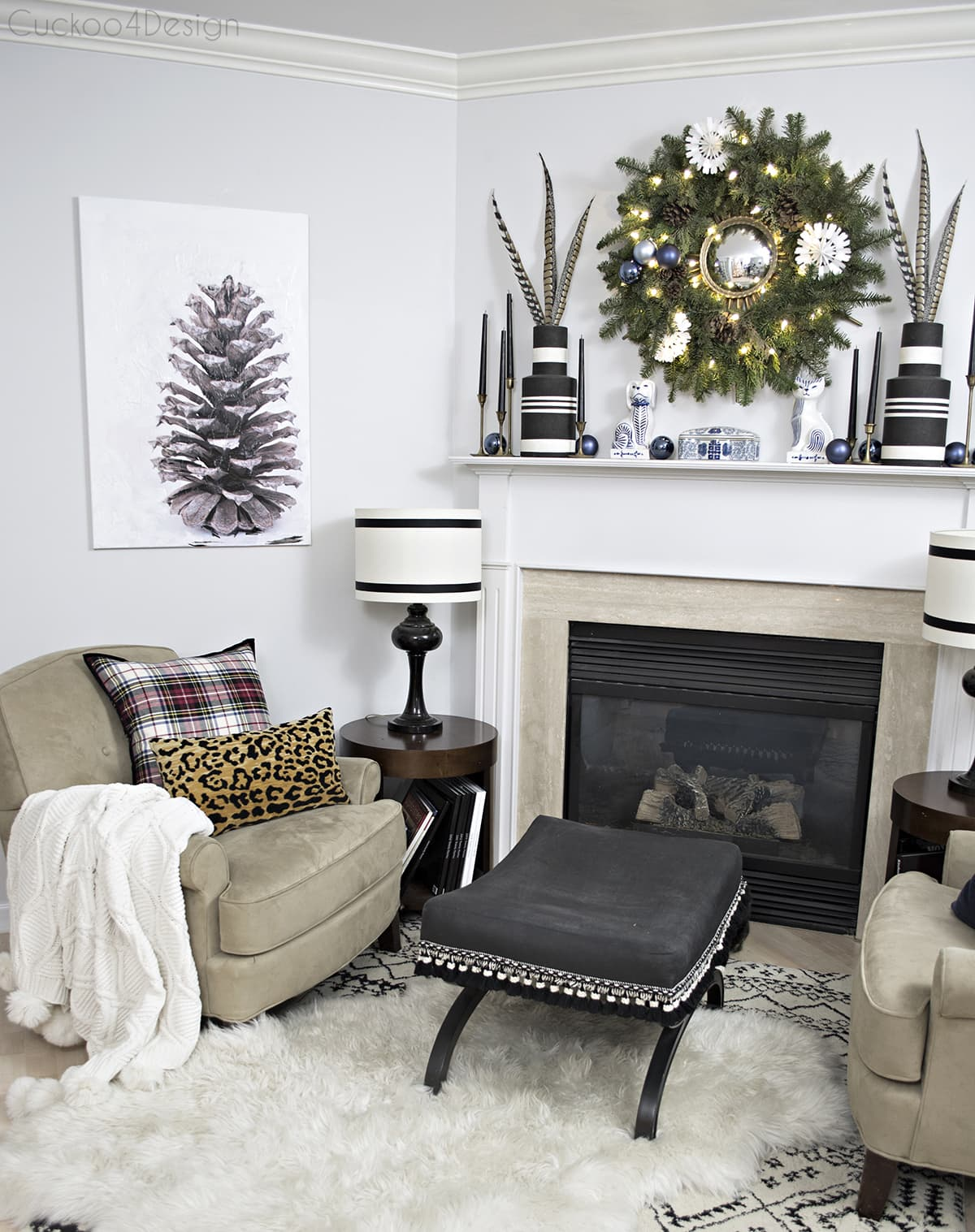 eclectic neutral Christmas fireplace area with DIY pinecone art