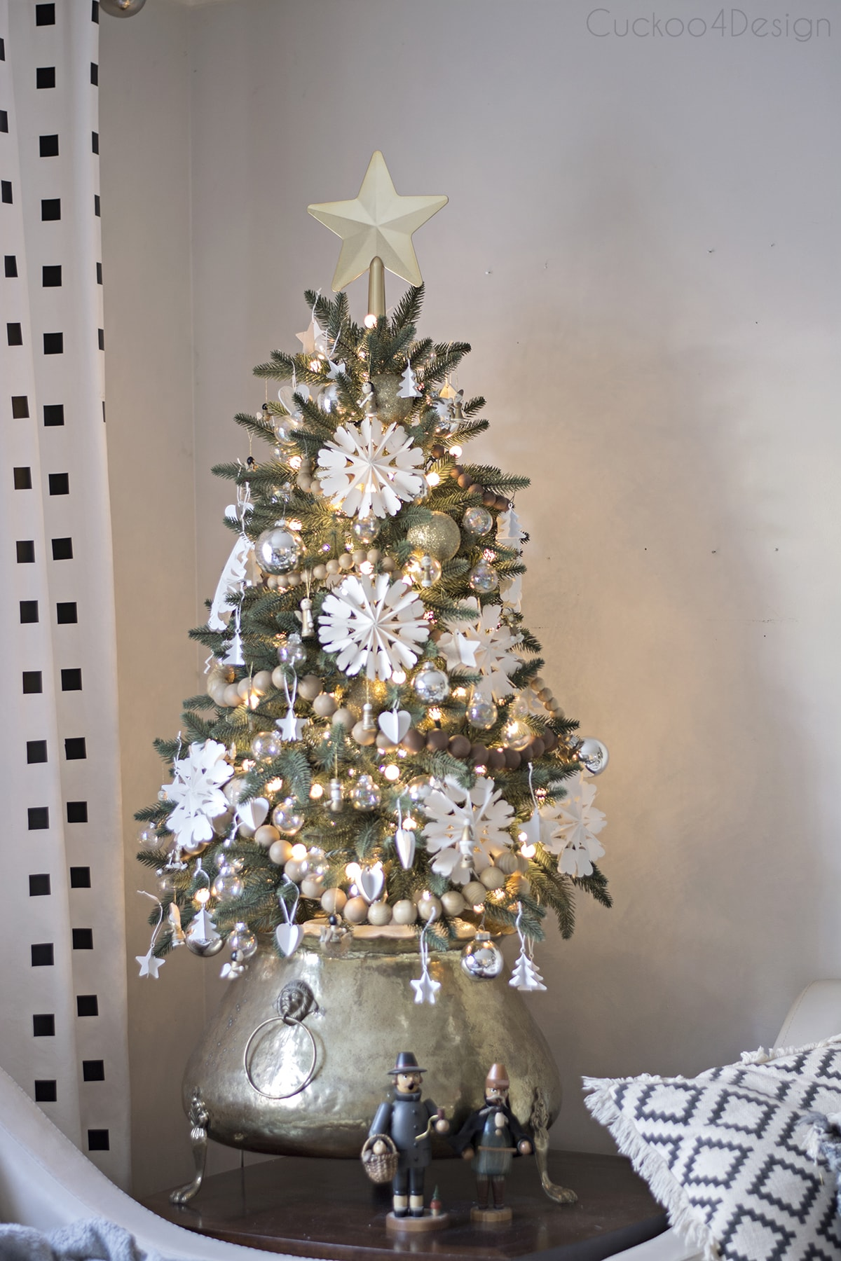 faux Christmas tree with white snowflakes and woodbeadgarland