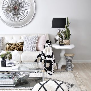 neutral eclectic bedroom with black and white and pink accents