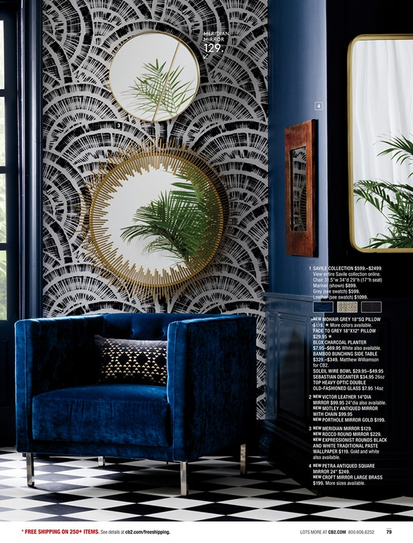 CB2 catalog page with black and white wallpaper and blue and gold accents