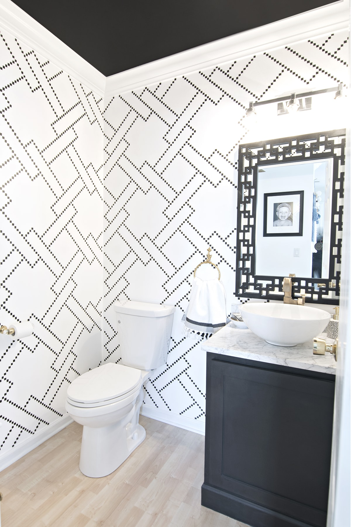stylish black and white powder room