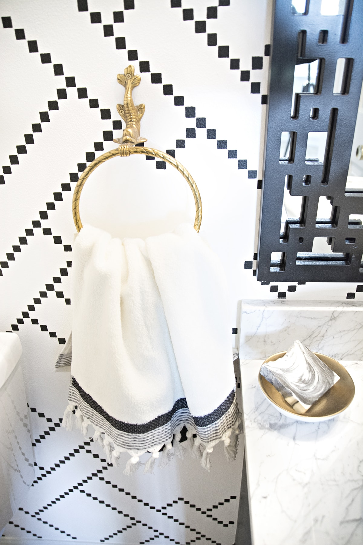 black and white geometric powder room