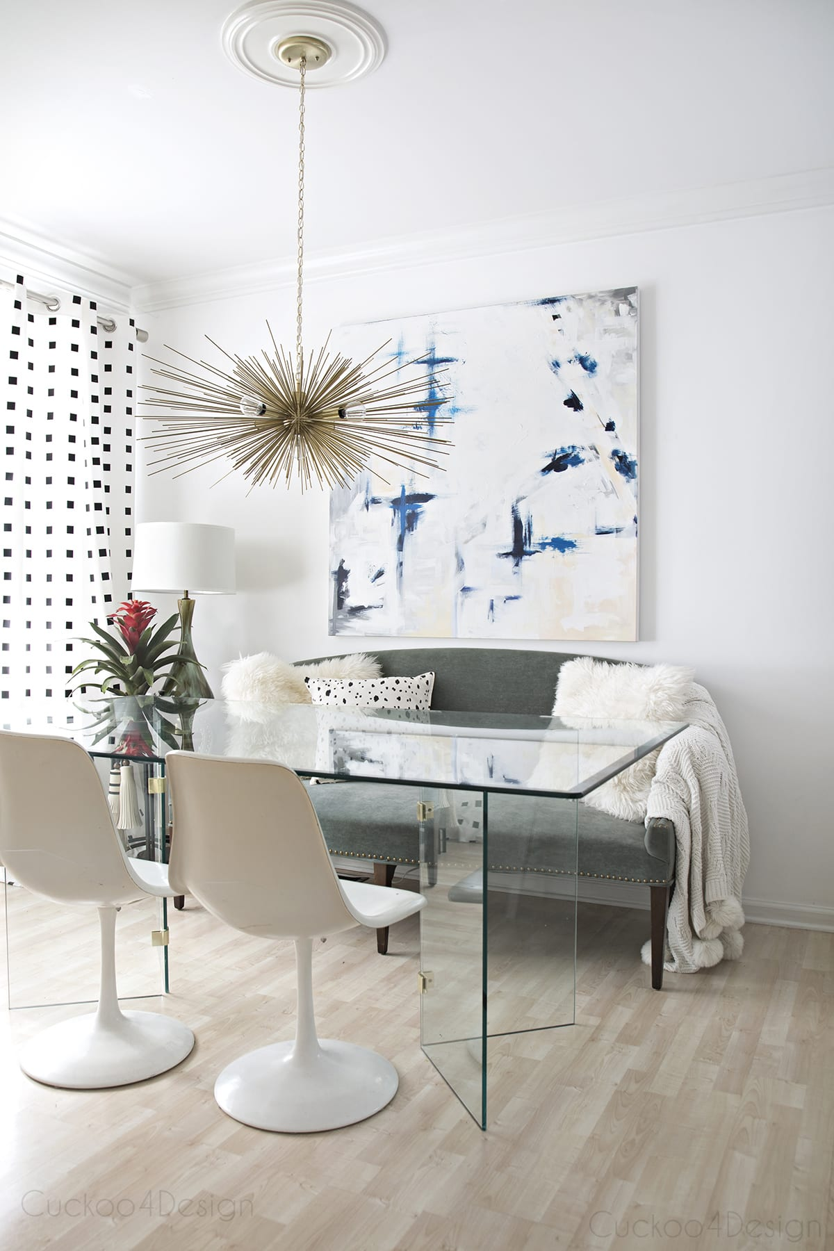Neutral eclectic dining room with blue accents
