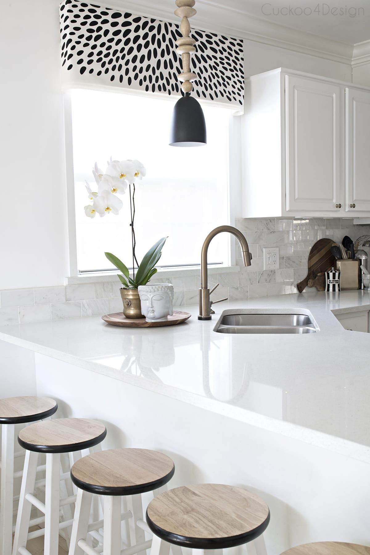 white kitchen with back and white accents