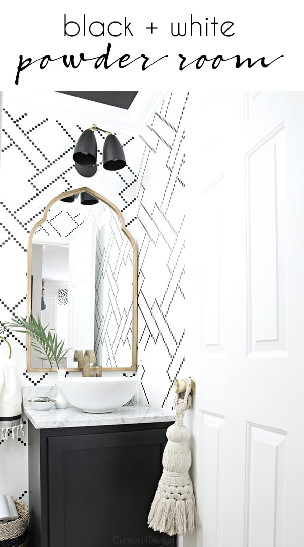 black and white powder room with gold accents and an eclectic  global vibe | stenciled black and white walls | little square stenciled wall | sharpie wall | black vanity with gold accents and marble top #powderroom #blackandwhite #bathroom