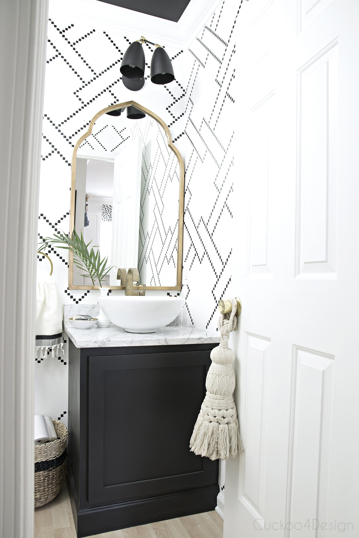 black, white and gold powder room with sharpie stenciled walls