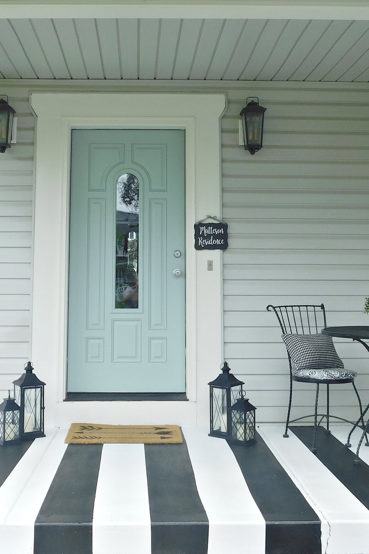a readers black and white striped porch