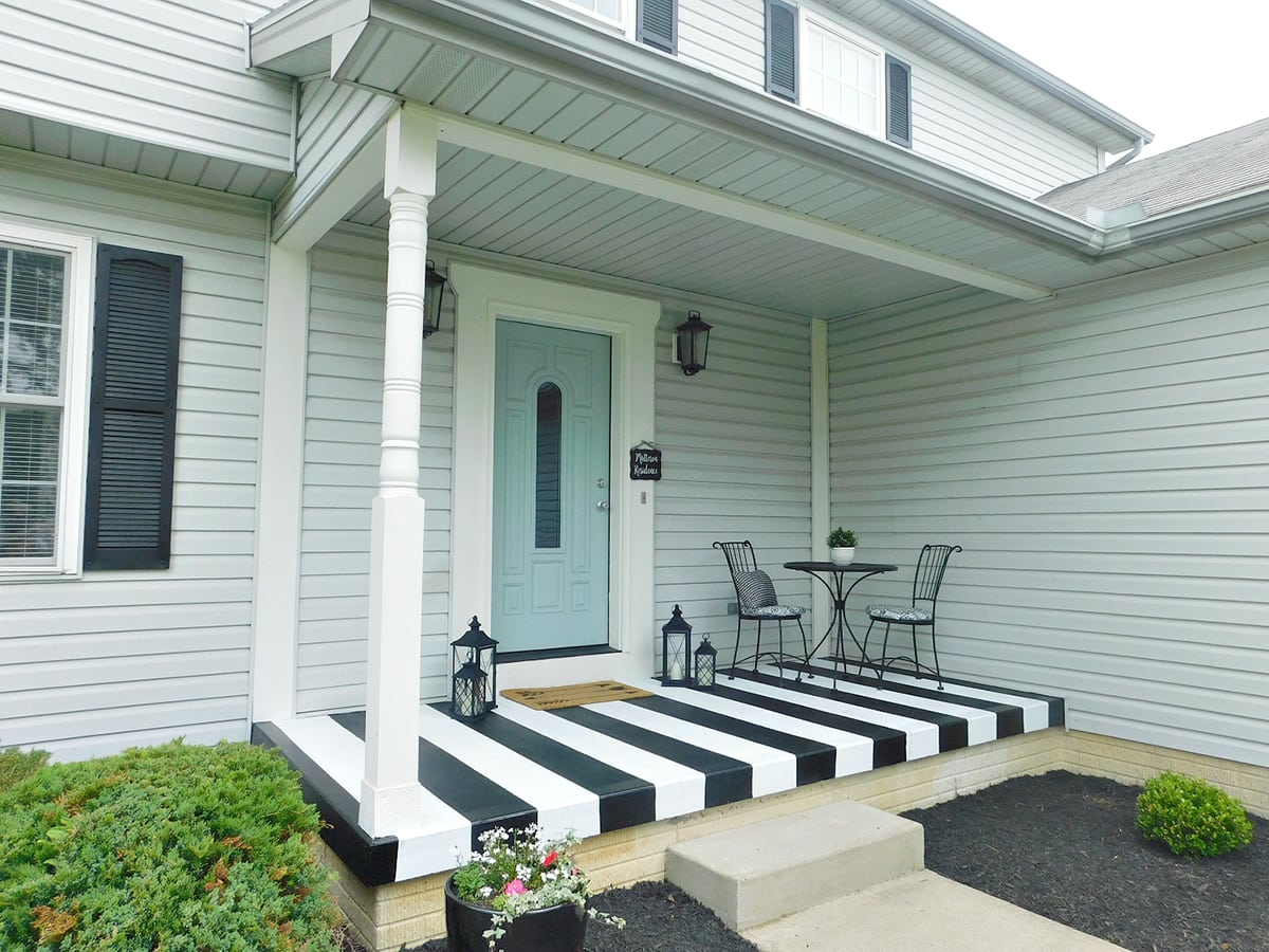 concrete black and white striped painted porch