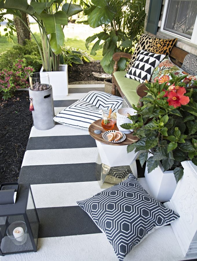 black and white striped porch with tropical colorful accents