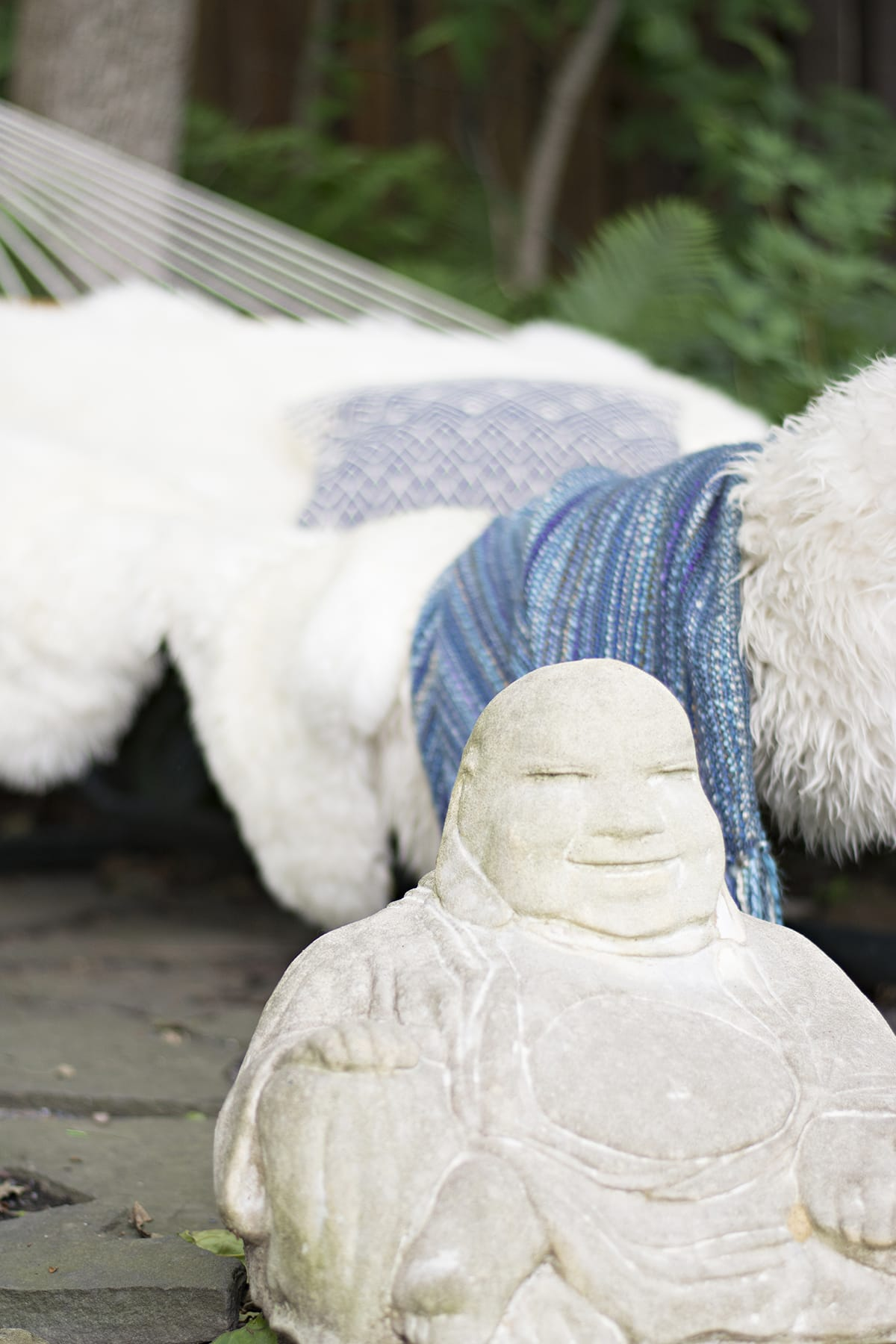 fringe hammock with fur and blue throw