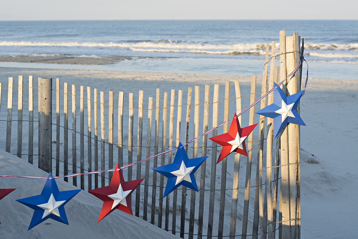 patriotic star bunting on the beach