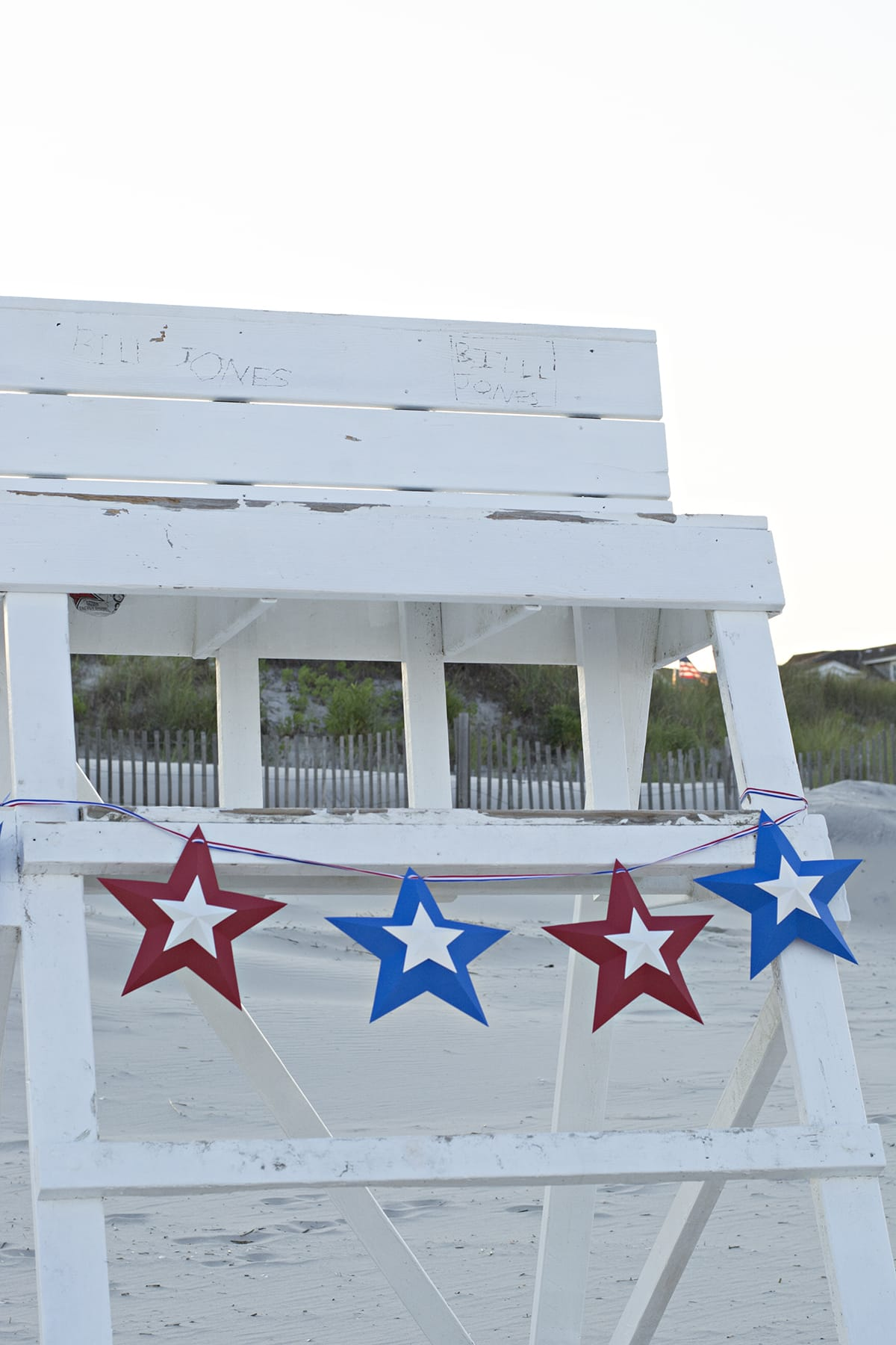 fourth of July star bunting hanging on a lifeguard stand as photo back drop