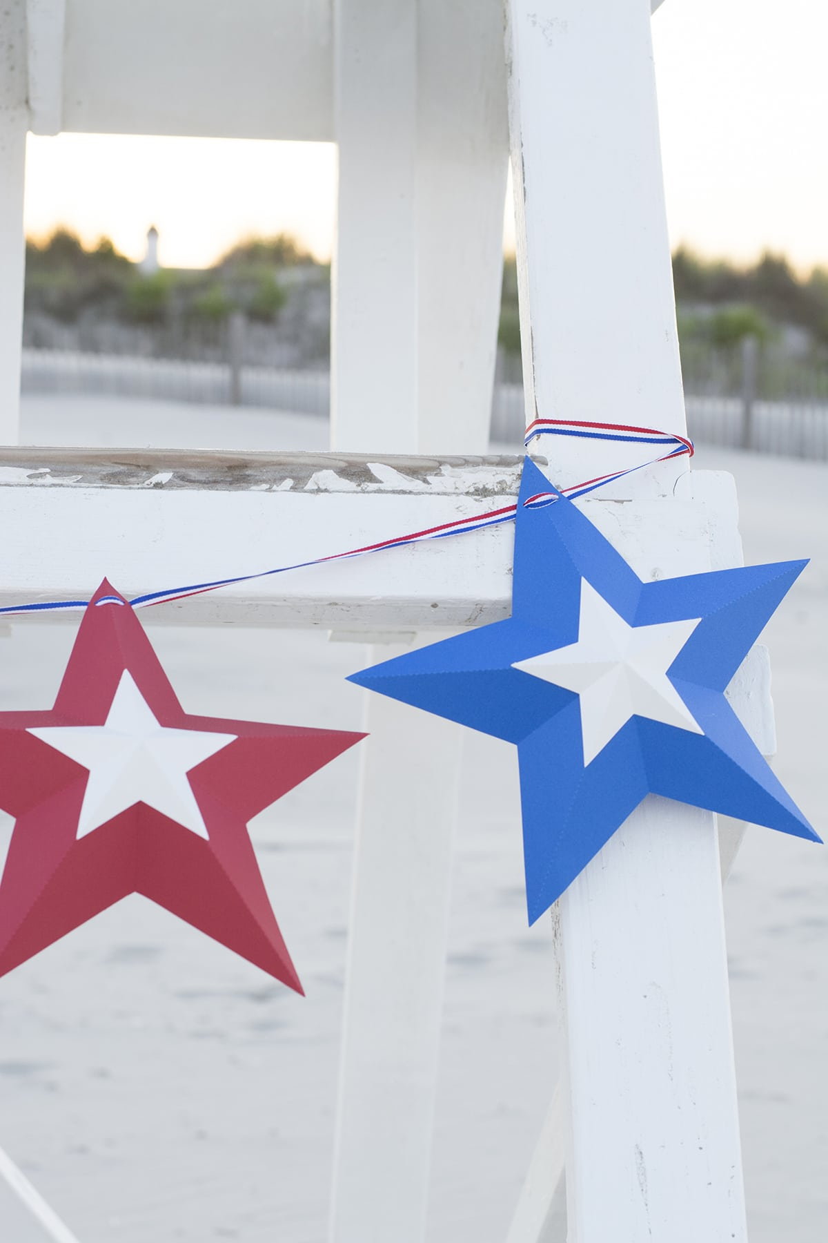 fourth of July star bunting hanging on a lifeguard stand