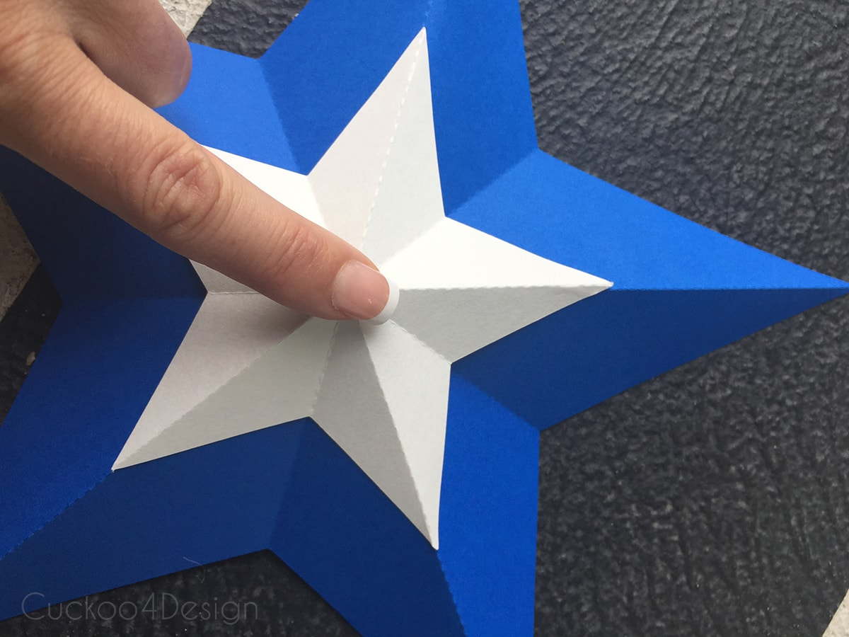 making blue and white stars for star bunting
