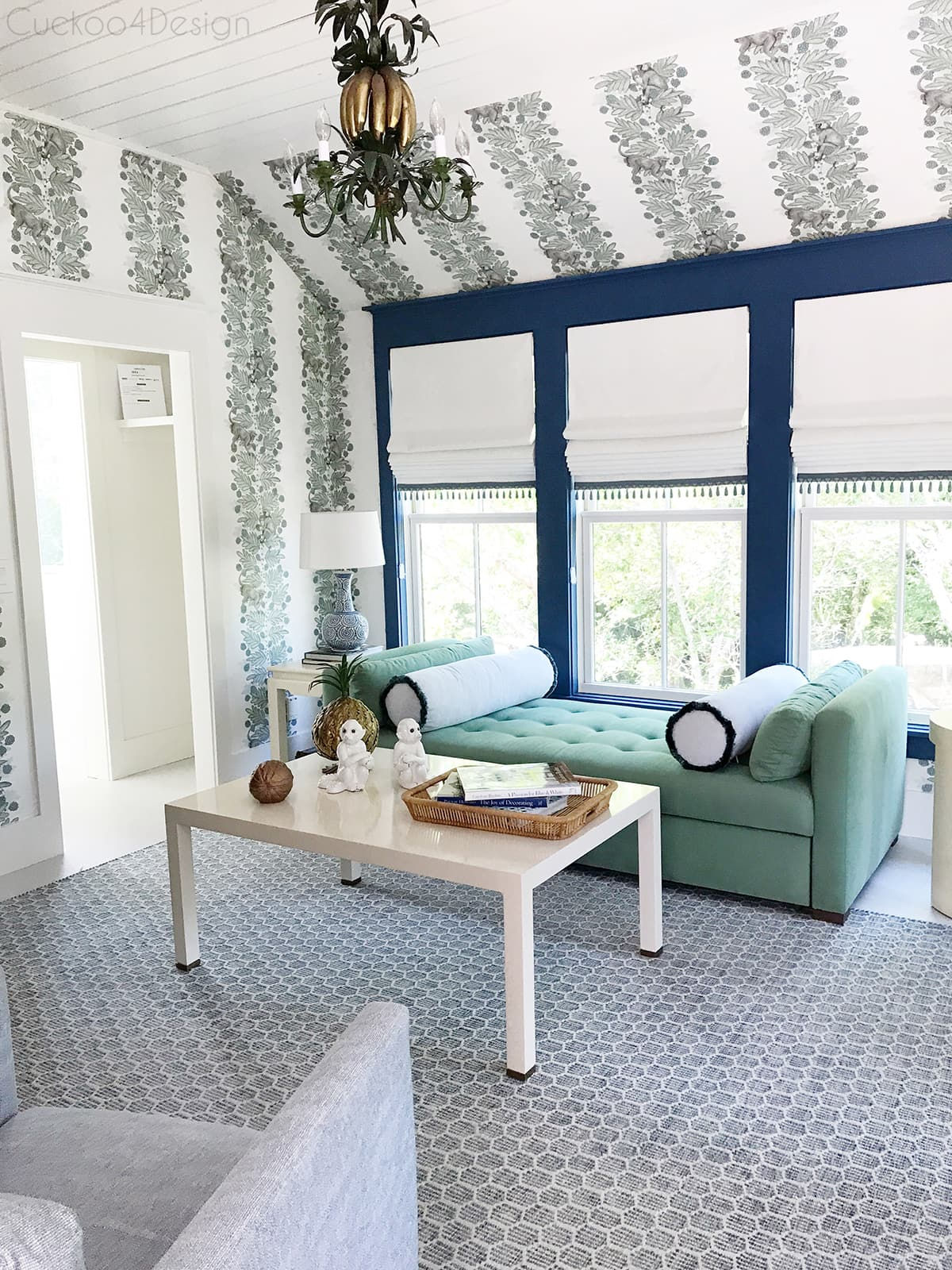 beautiful blue and green guest bedroom with green velvet daybed, striped monkey wallpaper, banana leaf chandelier and white lacquered, tables - blue kitchen cabinet kitchenette