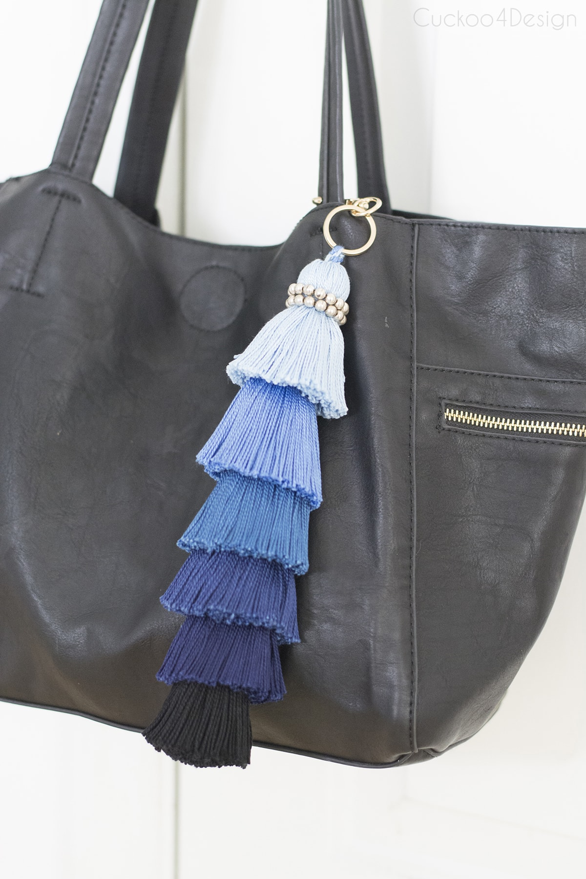 large blue ombre stacked tassel on a black purse