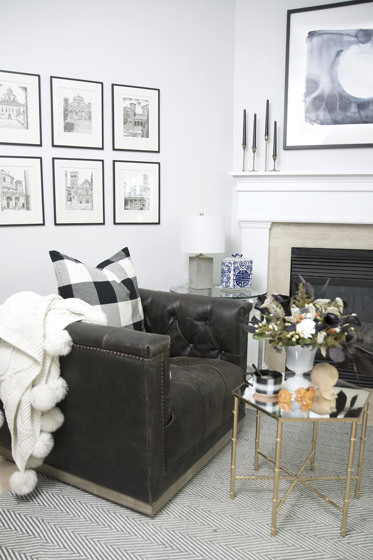 modern and minimal fall decor in this eclectic home tour | orange hot peppers instead of pumpkins with black calla lilly's for modern fall decor | buffalo check