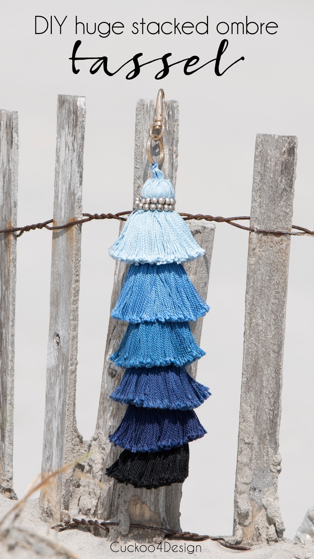 huge stacked ombre tassel hanging on beach fence