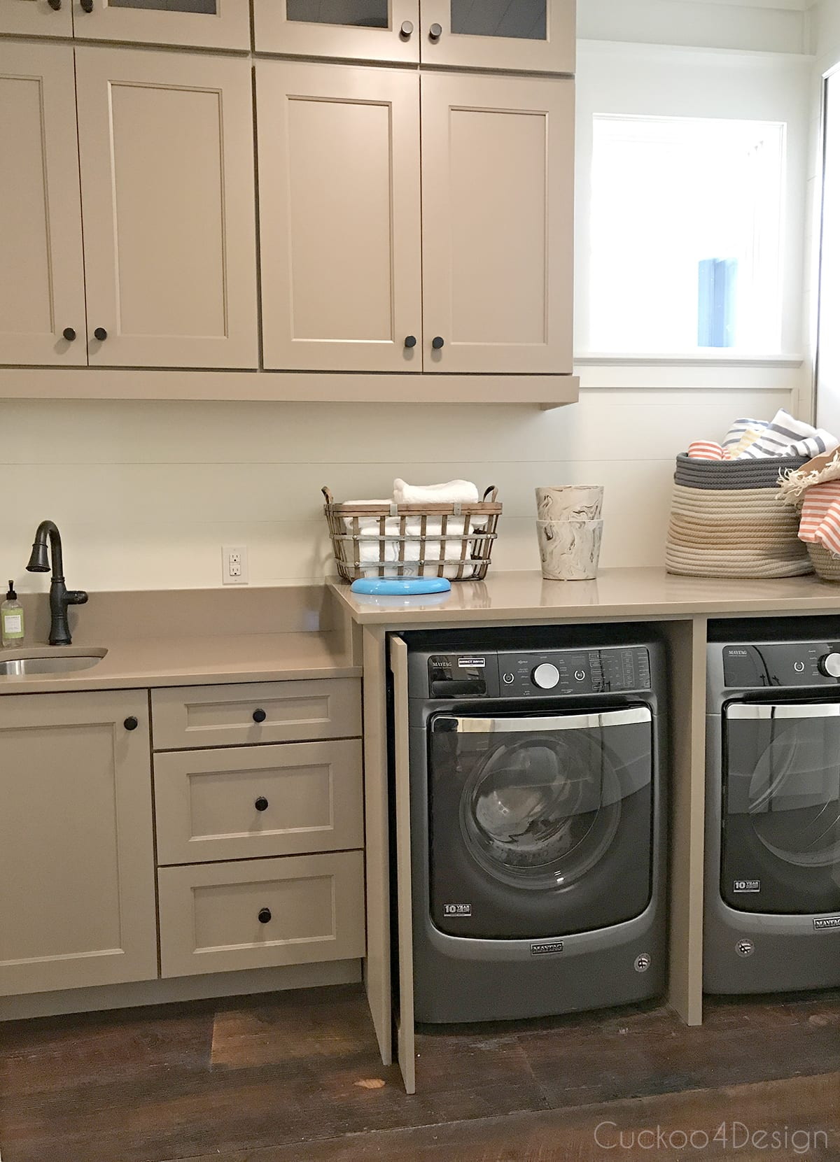 latte colored kitchen cabinets in laundry