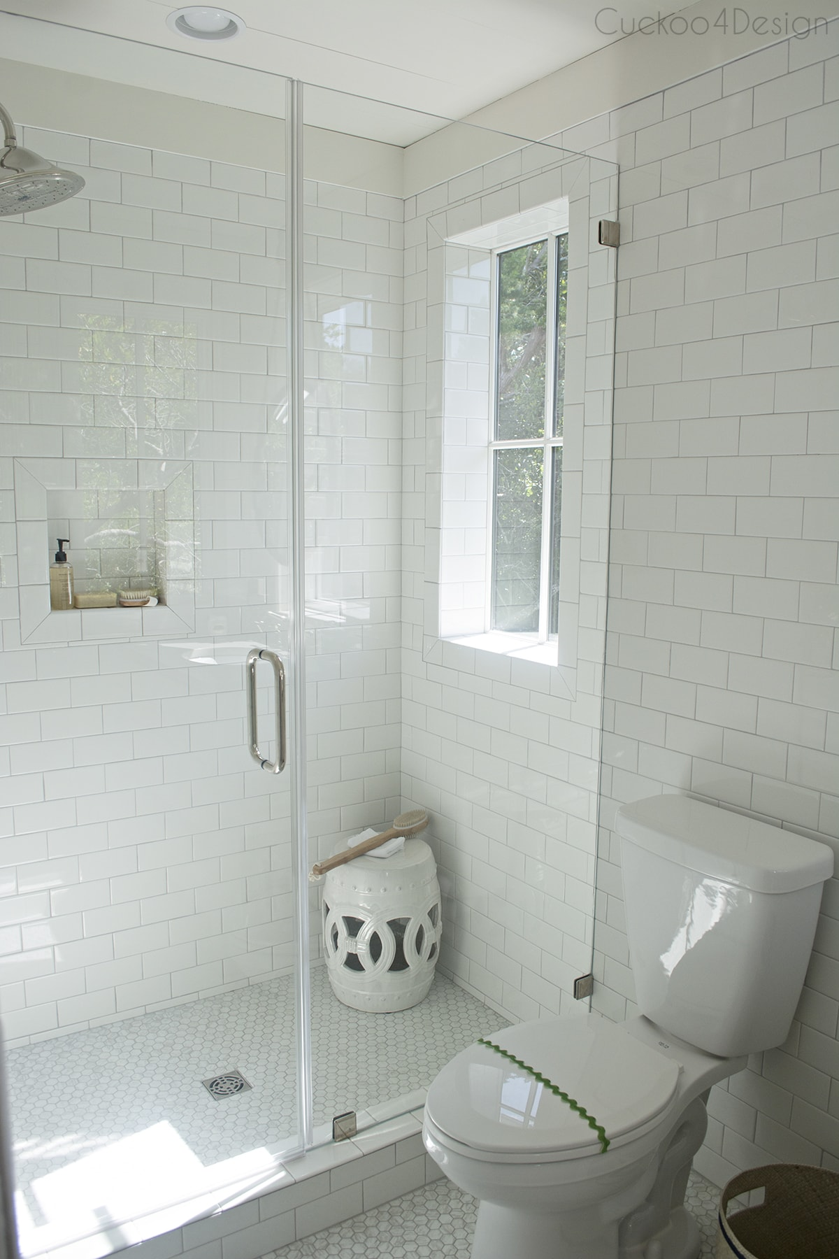 white and marble penny and subway tile crofter bathroom