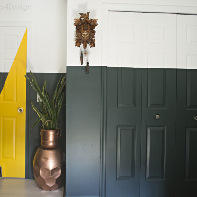 Dark green and white two-toned walls with yellow accents